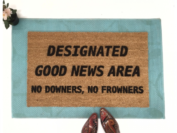 Designated Good News Area- no downers, no frowners! This funny doormat