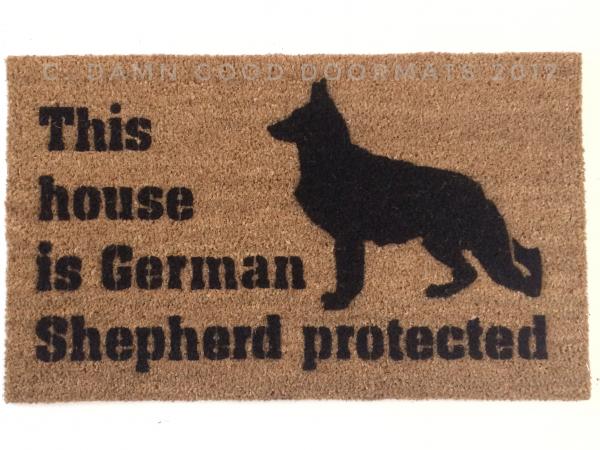 This house is German Shepard protecteddog door mat