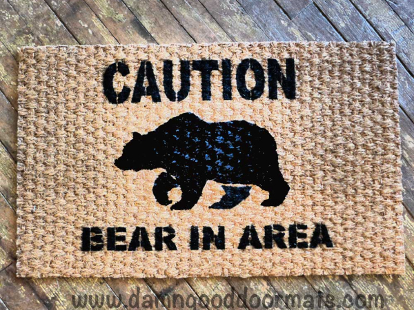 THIN-caution bear in  area-doormat