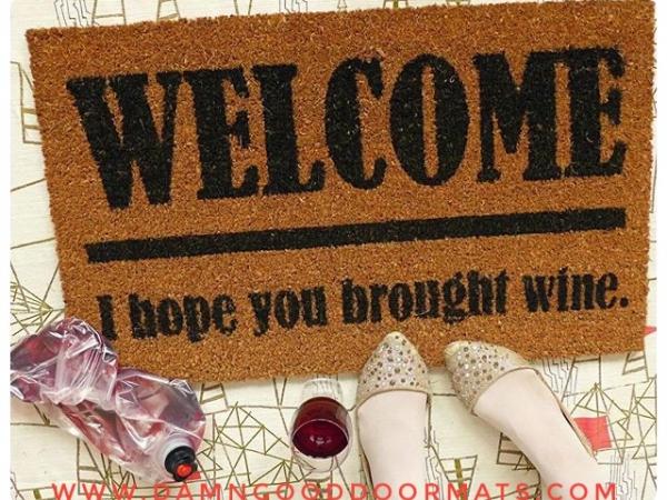 WIne! Welcome I hope you brought... doormat
