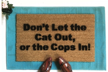 dont let the cats out or the cops in funny doormat