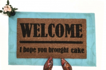 CAKE! Welcome I hope you brought... doormat