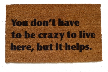You don't have to be crazy to live here, but it helps. funny doormat