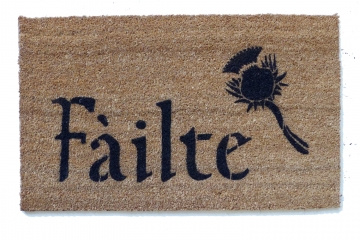 Scottish Fáilte and thistle or Irish Harp