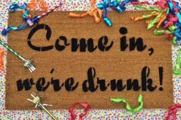 Come in, we're drunk!™ funny doormat