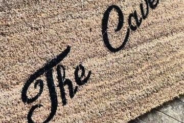 The Cave, Man Cave doormat