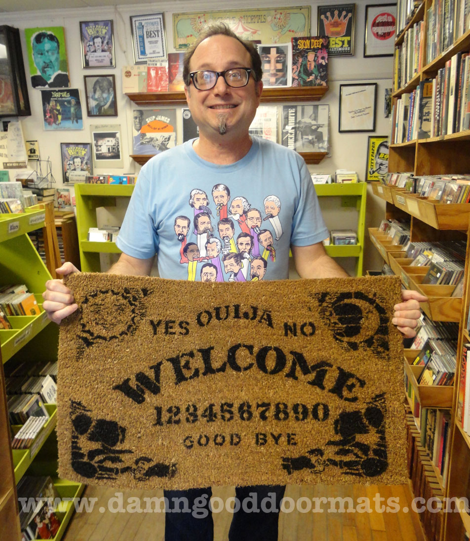 Rupert at Normal's Books with Ouija doormat